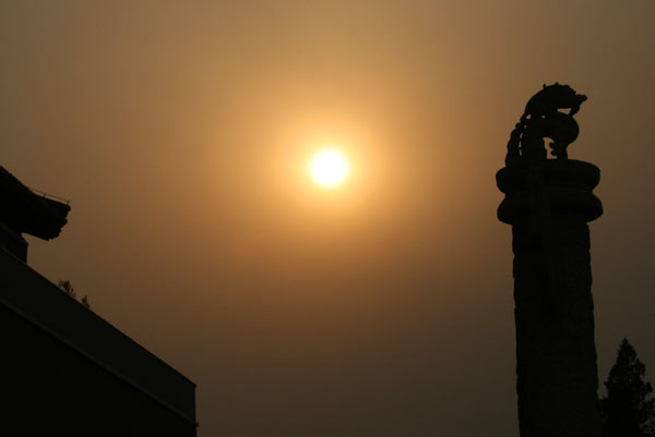 The late afternoon sun tries to break through Beijings impeneterable haze