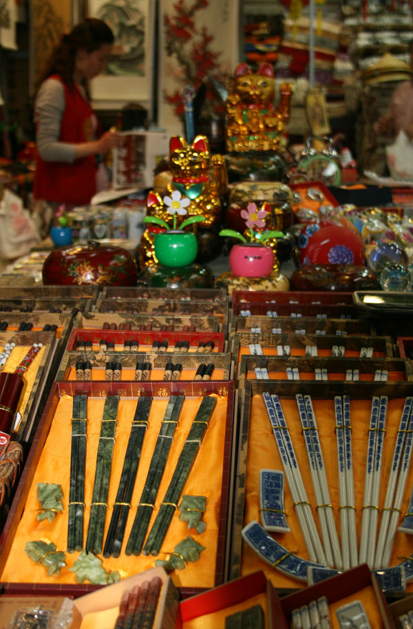 One of the many stalls with curios, ornaments and .... chopsticks